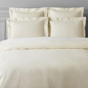white bed sheets and pillows to represent how  how our online CBT-I course can treat adult insomnia and help you sleep more!